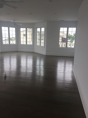 Staged Long Island | Staging Your Home For Sale | Home Stager | Configuring Your Home | Increase Value | Sell Your Home | Living Room and Dining Room | Before