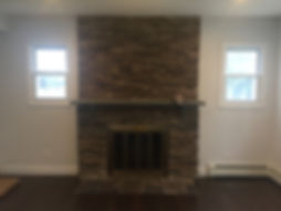 Staged Long Island | Staging Your Home For Sale | Home Stager | Configuring Your Home | Increase Value | Sell Your Home | Living Room with Stone Fire Place| Before