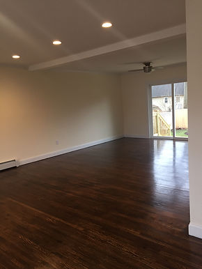 Staged Long Island | Staging Your Home For Sale | Home Stager | Configuring Your Home | Increase Value | Sell Your Home | Living Room | Patio Door | Before