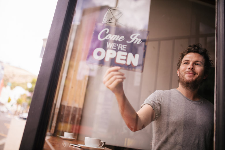 stellar it solutions miami florida business owner turning come in we're open sign
