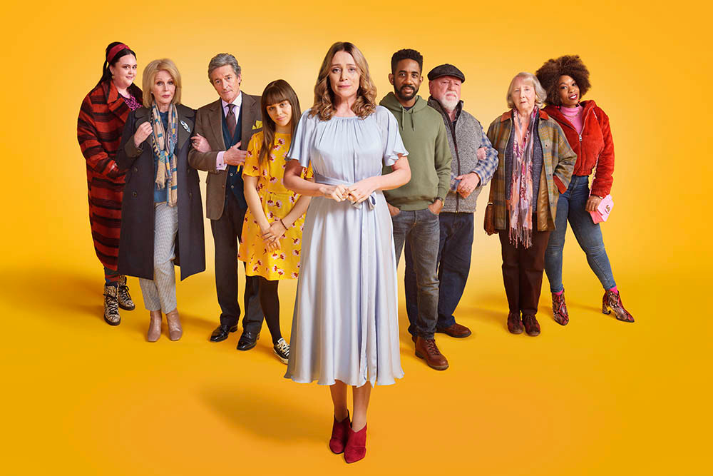 Cast of Finding Alice pose for a group shot on a yellow background.
