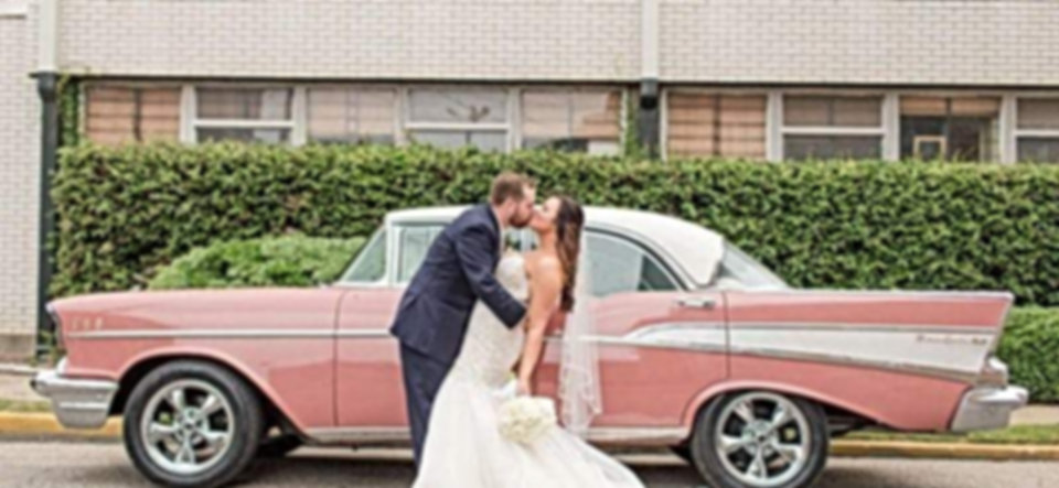 The Perfect Kiss in front of the 1957 Chevy BelAir