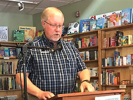Kenneth Chamlee giving a poetry reading at Malaprops Bookstore in Asheville, NC.