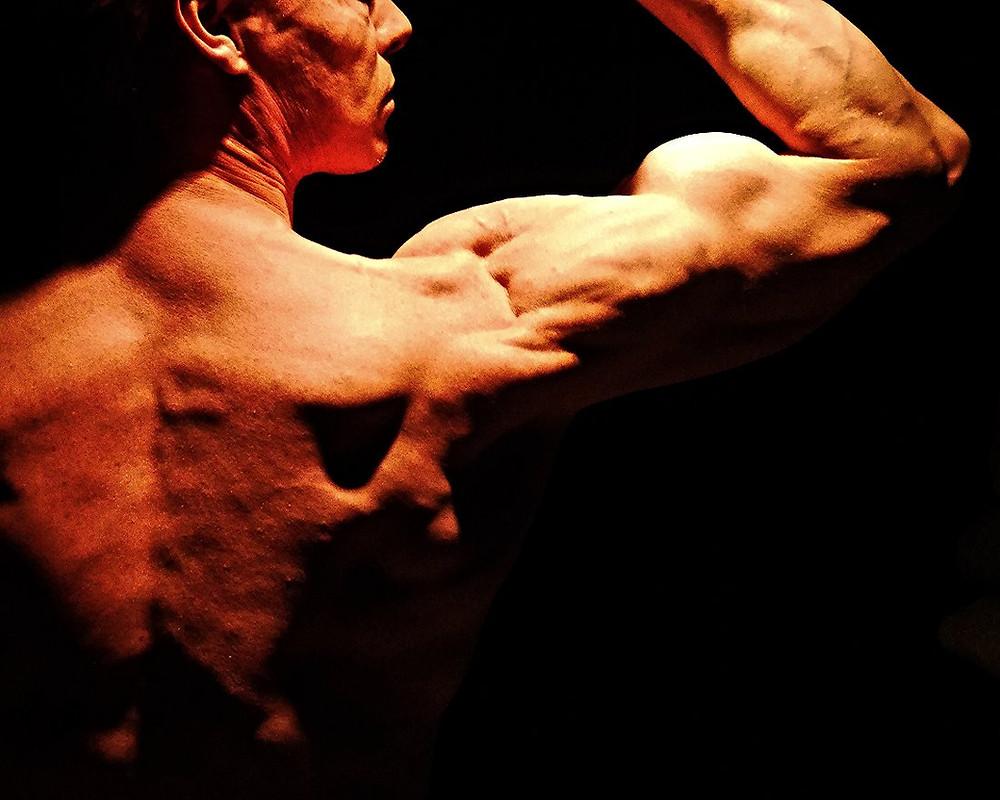 Daniel Schou flexing biceps