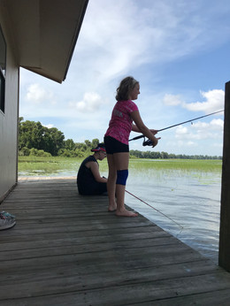 Campers Fishing At Camp Frontier