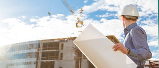 architect-in-helmet-with-blueprints-look
