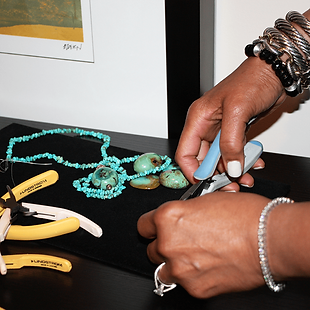 G. Denise Barksdale at work in her studio crafting her jewelry