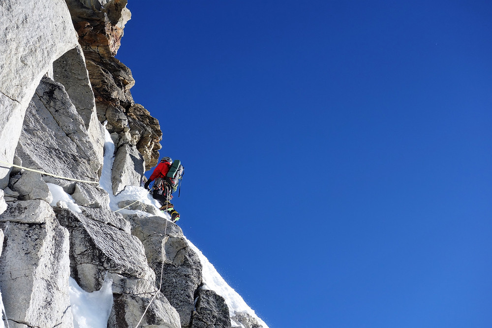 I contemplate the overhangs of the crux pitch ahead