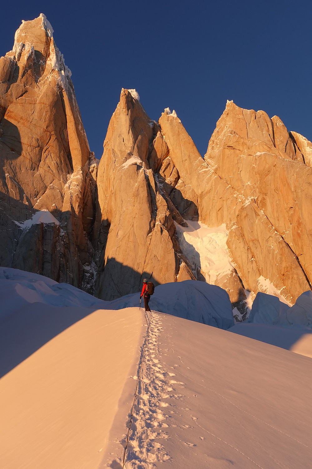 Brette harrington approaches MA's Vision on Torre Egger with Cerro Torre (left) and Cerro Standhart (right). Photo: Quentin Roberts