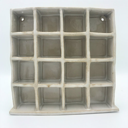 miniature display case with 16 cube spaces