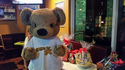 CHEO Bear working at the Silent Auction Table