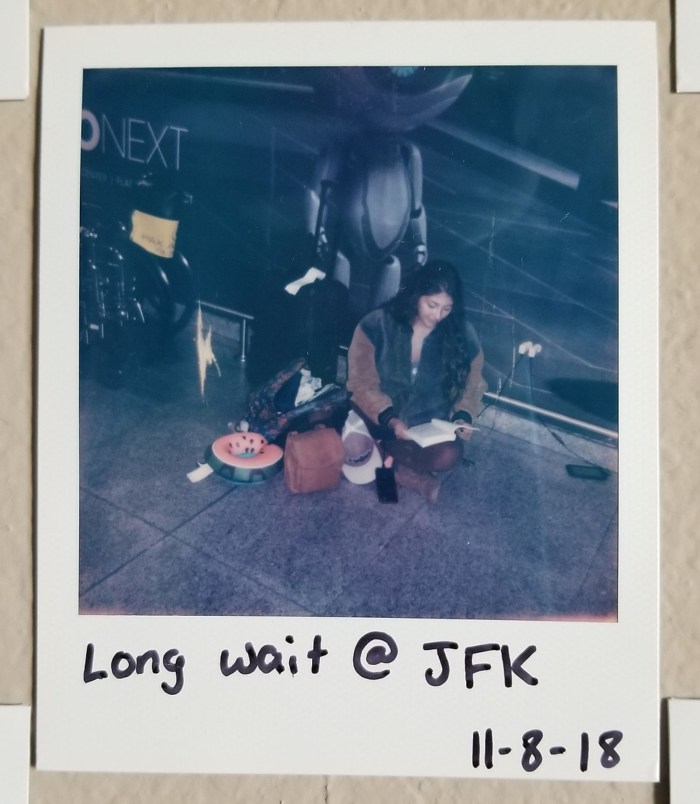 polaroid, airport wait, long wait, sitting in a new place, waiting, waiting in an airport, solo travel, travel tips, alone, polaroid picture