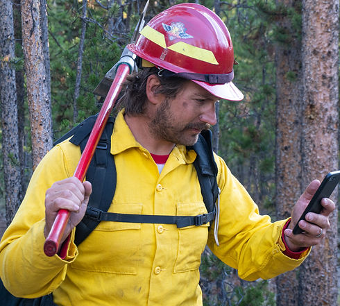 Wildland Fire axe on shoulder looking at