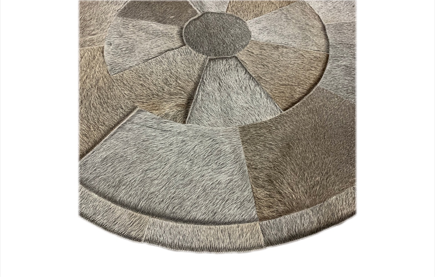 Patchwork cowhide rug , round, grey colour