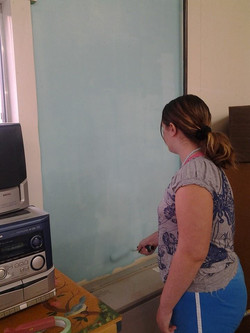 Sylvia gettin the walls ready