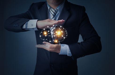 business-man-holding-brain-palm.jpg