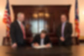 Gov. John Kasich signs bill with Ohio Senate President Keith Faber and Ohio News Media Association president Dennis Hetzel