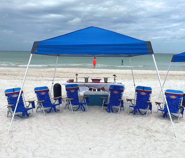 Tent with Chairs at the beach.
