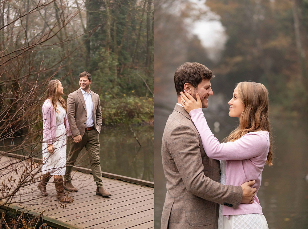 a couple walks on a bridge, a woman smiles at a man during their engagement photo session with Exeter wedding photographers, Sam and Jenna