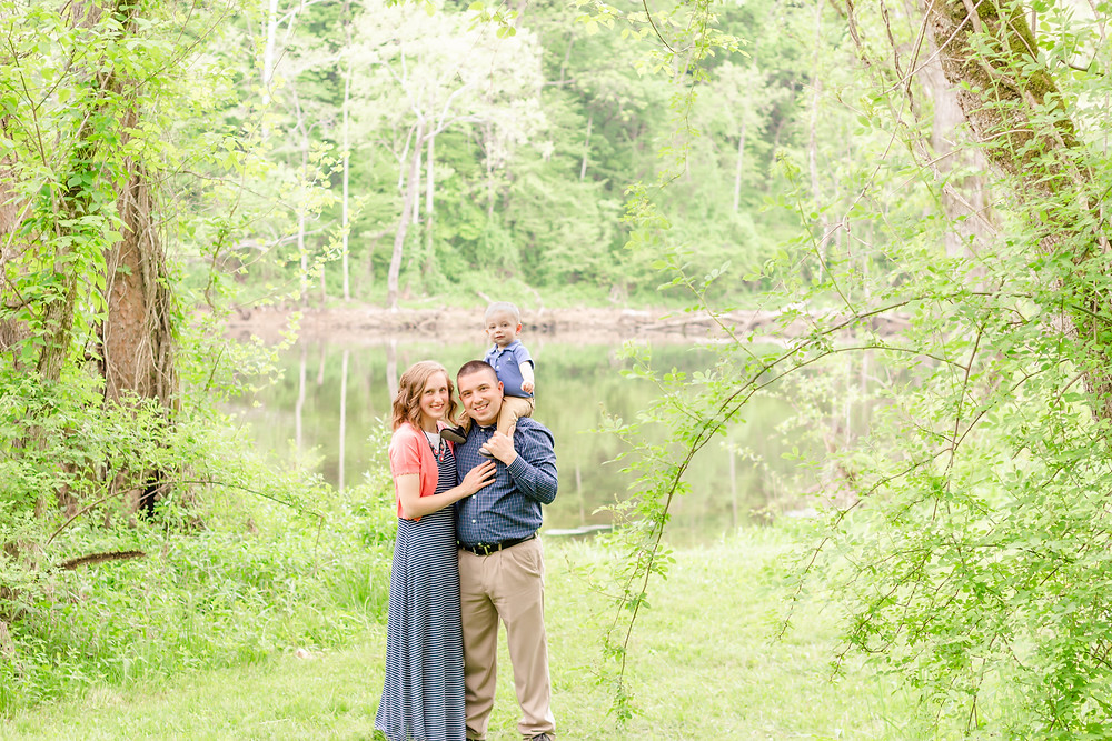 Light and airy family photo near a river taken by Exeter portrait photographer
