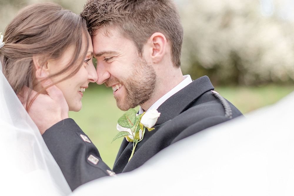 bride and groom smile at eachother during bride and groom photos with exeter wedding photographer Sam and Jenna Photography