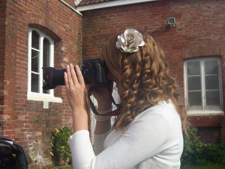 Devon wedding photographer taking photos at a wedding