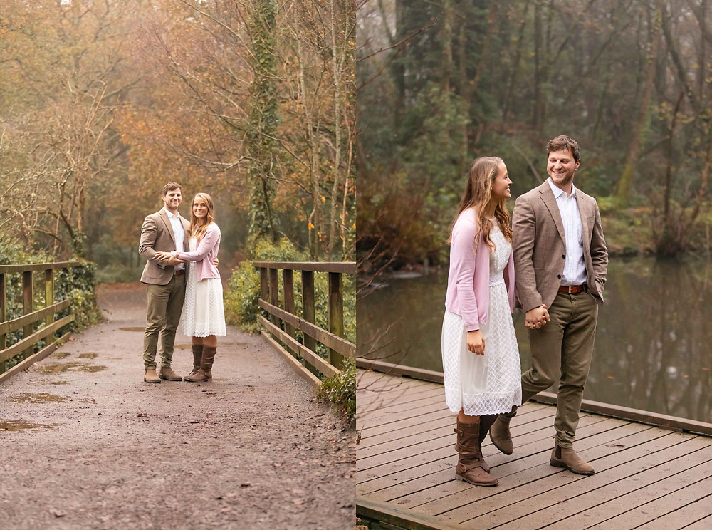 A couple stand on a lovely bridge in a country park during the Autumn. A couple smile at each other while walking on a wooden footbridge.