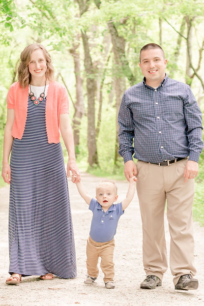 A beautiful family smiling during their family photo session in Exeter, Devon