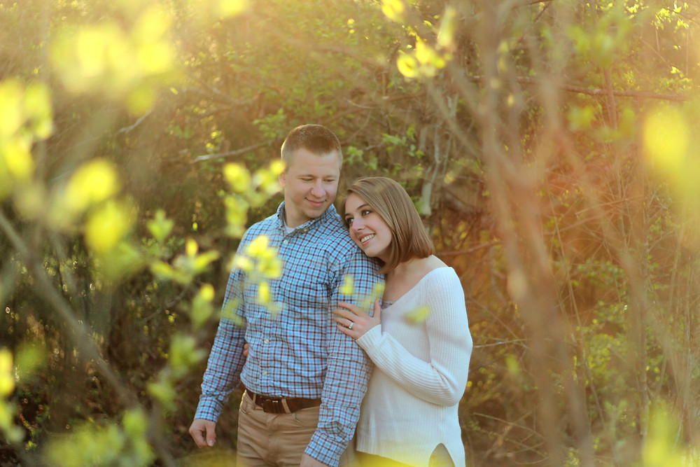 A couple lost in dreamy forest surroundings have their photo taken by Exeter wedding photographer