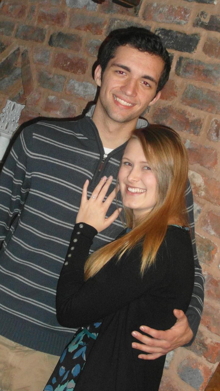 Sam and Jenna, newly engaged, smile at the camera before becoming wedding photographers