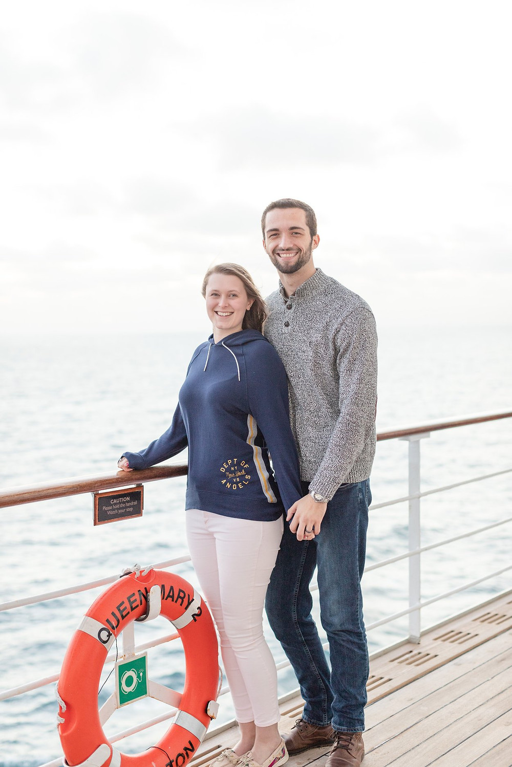 Couple standing on the deck of the Queen Mary 2 ocean liner | Exeter Photographer