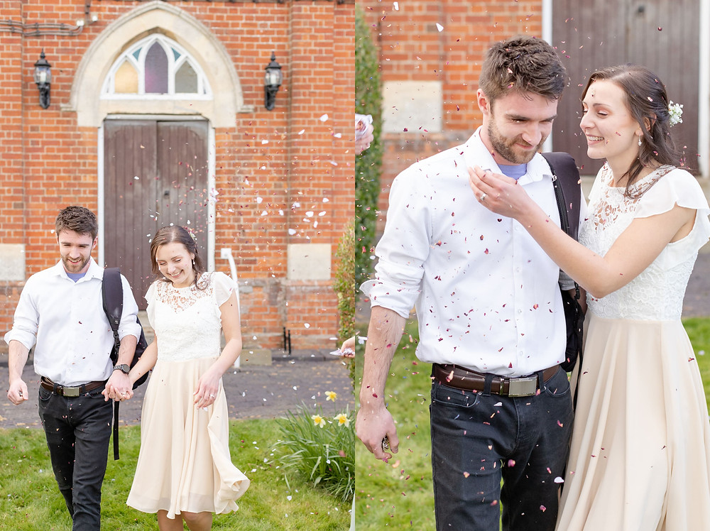 Bride and groom laugh as they leave their wedding surrounded by guests throwing biodegradable confetti