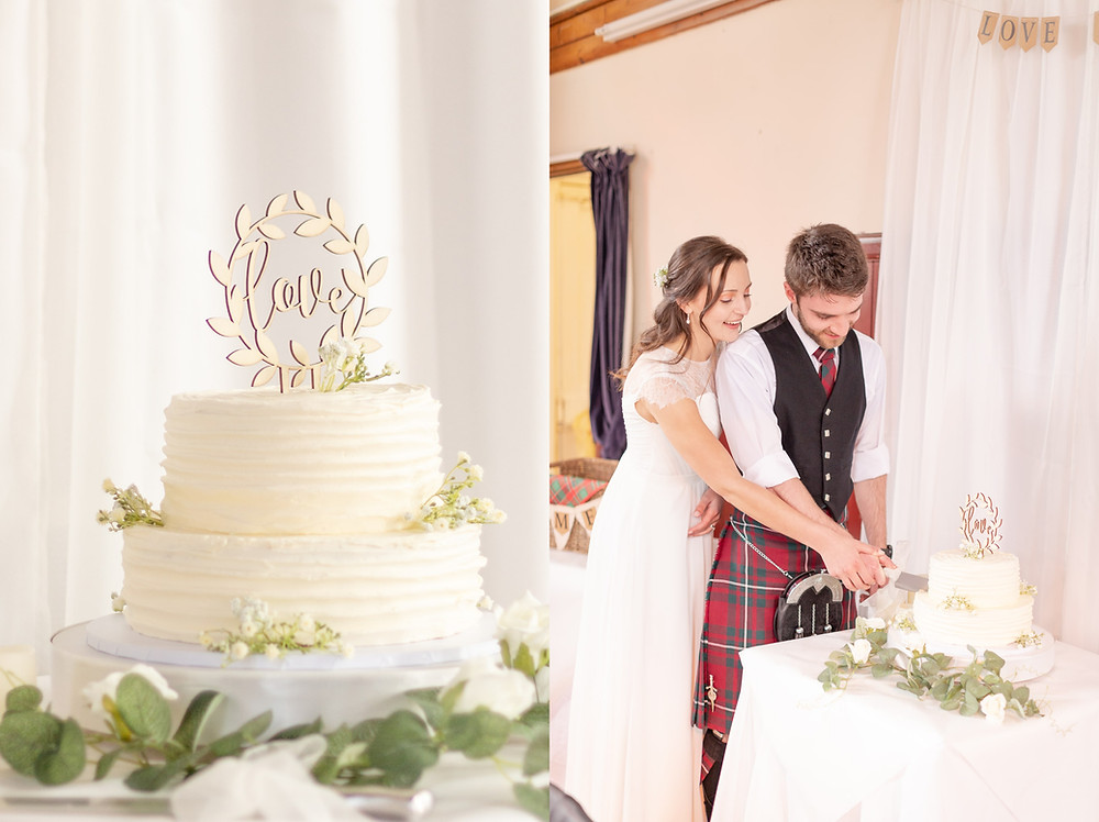Detail photo of a beautiful two tier wedding cake with wooded love sign, couple smiles as they slice the cake together.