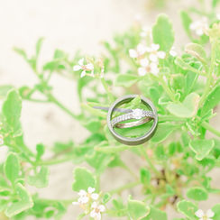Beautiful wedding rings during beach engagement session