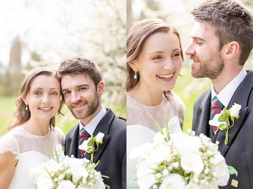 bride and groom smile at the camera, bride and groom laugh for portraits with Sam and Jenna Photography, Devon wedding photographer
