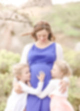 Maternity photo with little girls kissing mom's tummy by Exeter portrait photographer