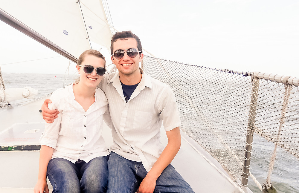 Honeymoon couple on a Sailboat having their photo taken