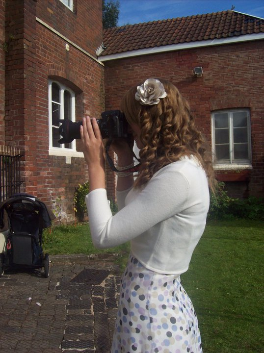 Exeter wedding photographer taking a photo at a wedding