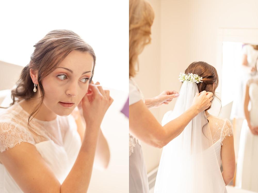 bride putting earings in, bride having wedding veil put on