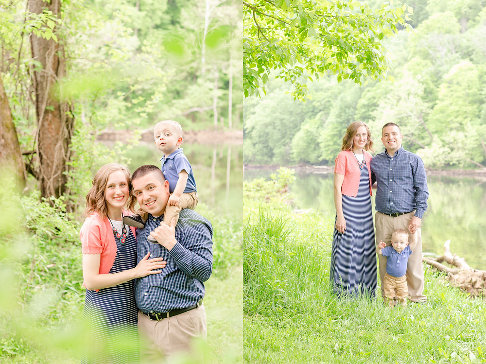 family of three are smiling during their portait photoshoot near a river