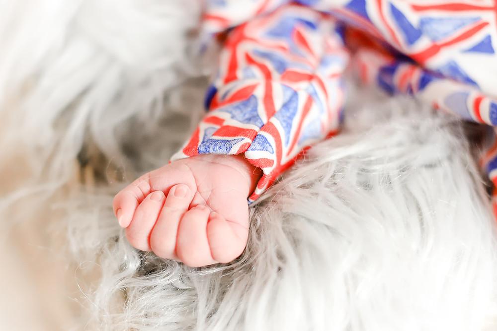 Close up photo of a newborn baby boy's tiny hand