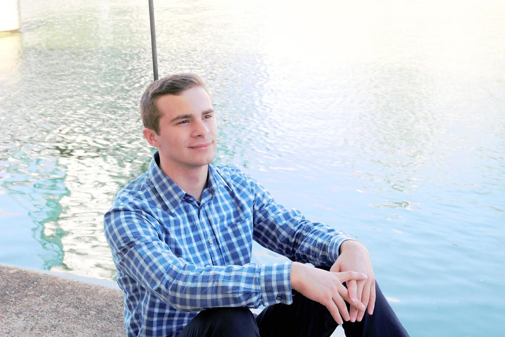 Model sitting beside lake