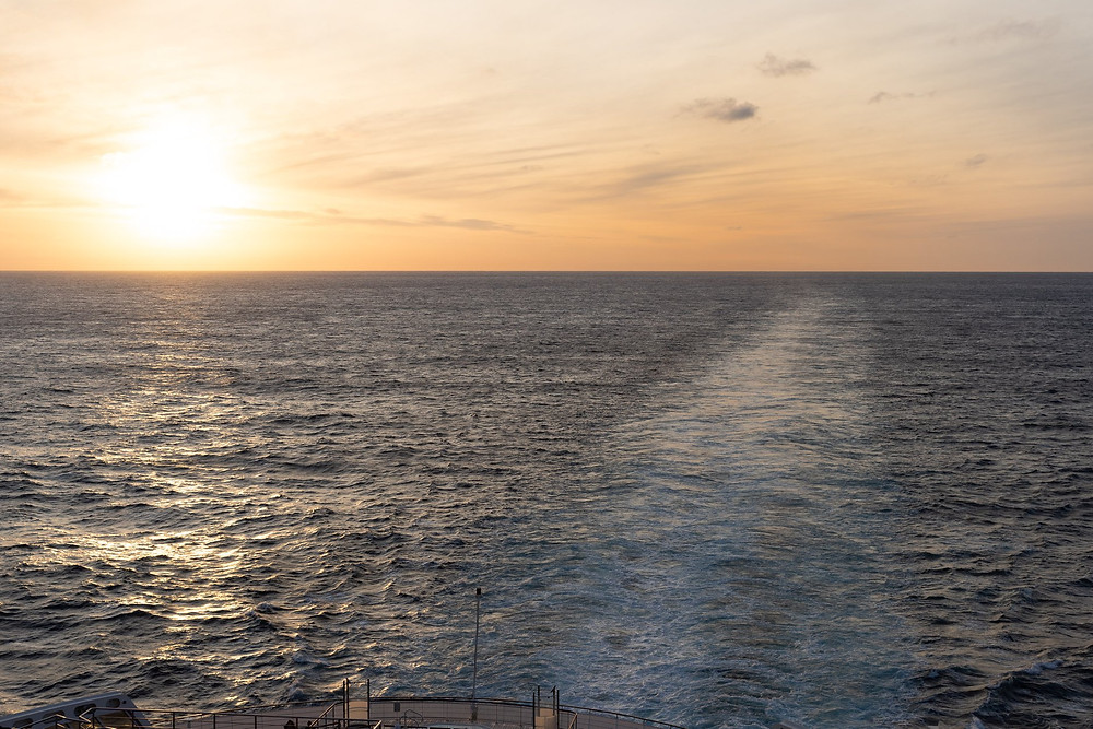 Beautiful sunset over the Atlantic Ocean off the back deck of the Queen Mary 2