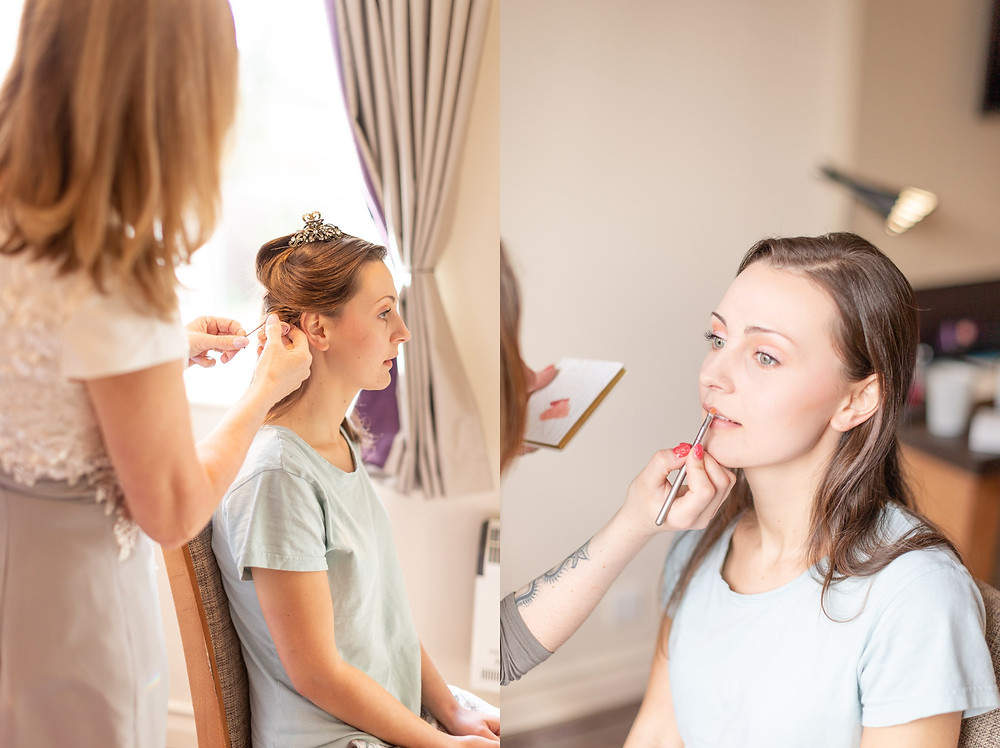 bride getting makeup and hair done on her wedding day