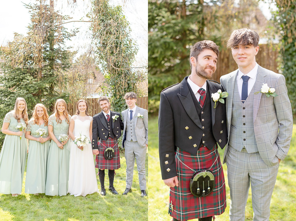 wedding party consisting of bride, groom, three bridesmaids, and best man all smile at the camera for a portrait. groom looks at best man and best man smiles at the camera.