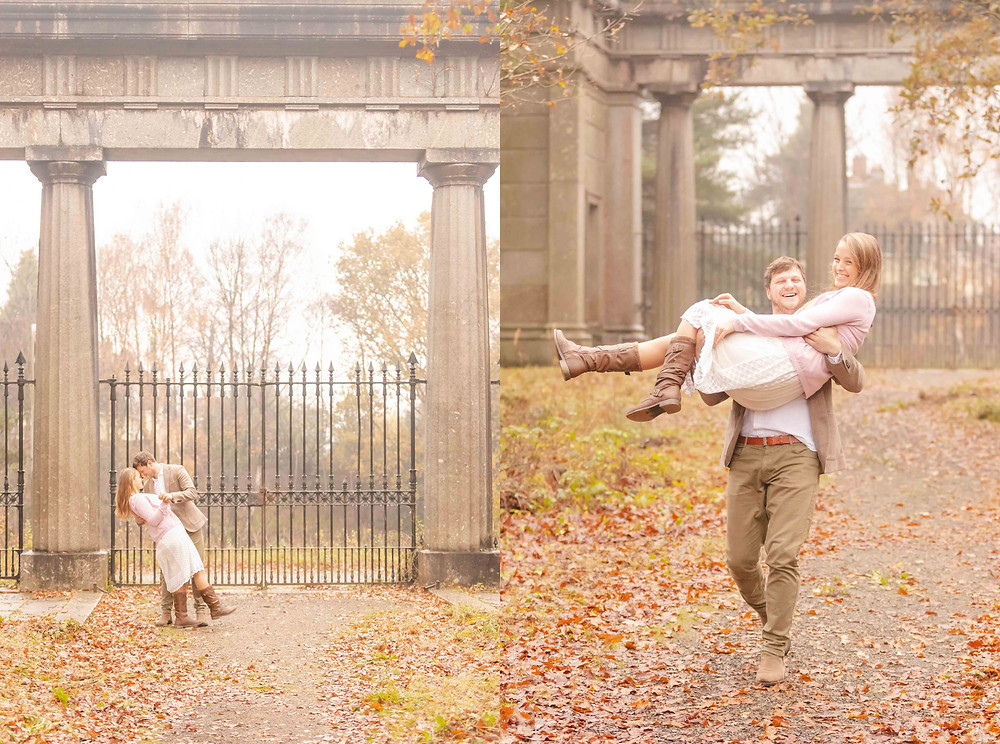 A man dips his future bride in front of Stover Country Park Gatehouse. A man carries his fiancée and both laugh.