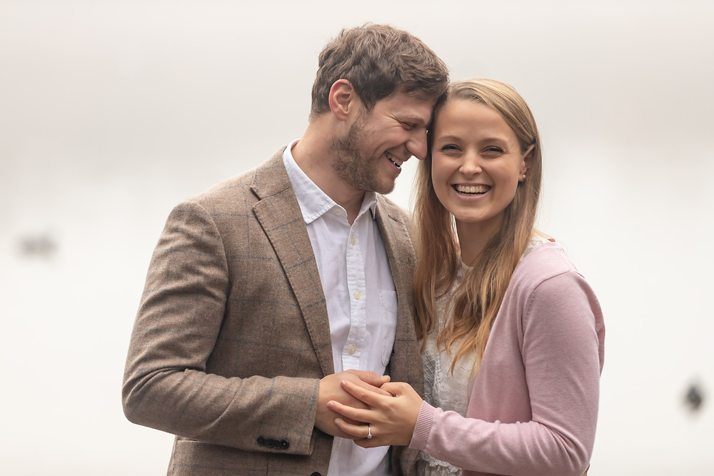 An engaged couple enjoy a happy moment in Stover Country Park