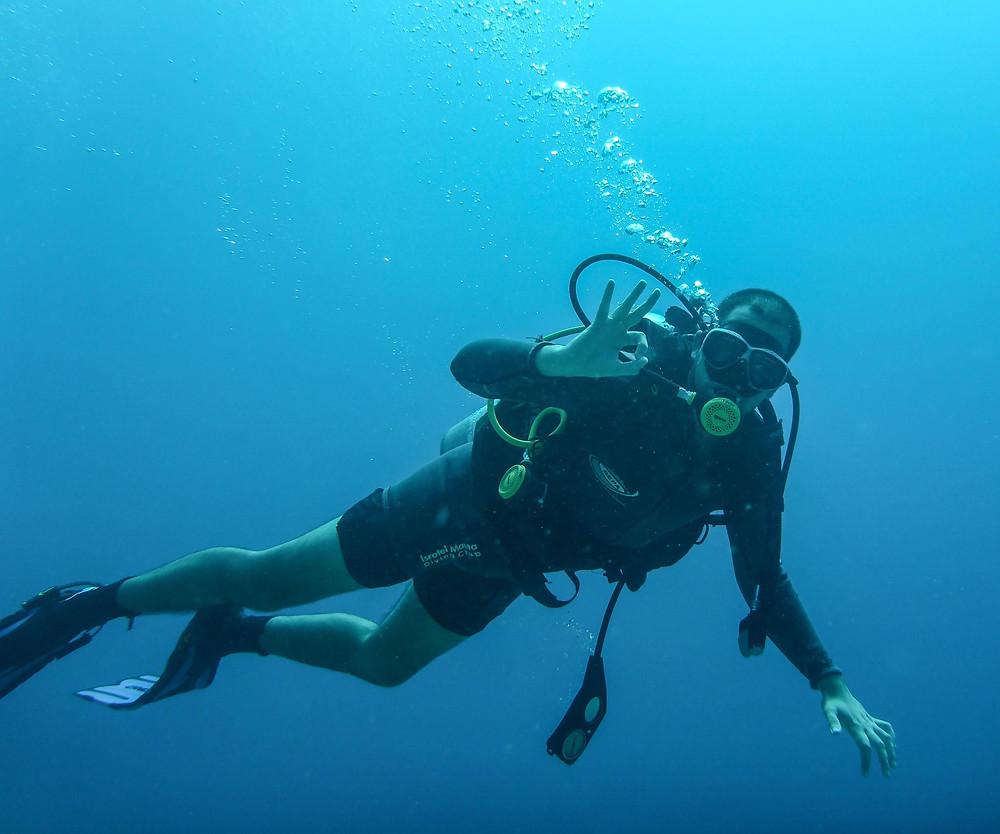 Guy dives in Eilat.