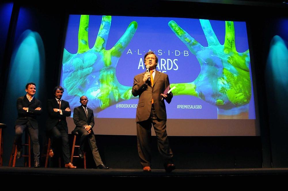 IDB President Morena speaking at ALAS-IDB Awards, with FONSECA, Alas' Juan Pungiluppi, and Actor/Producer Dale Godboldo