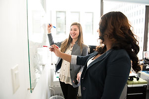 two-women-in-front-of-dry-erase-board-11